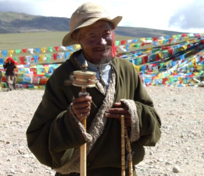Tybetańczyk z młynkiem i malą